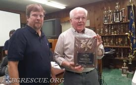 Fredericksburg Rescue Squad Chief Troy Payne presents a plaque to Life Member John Cook to honor his 50 years of membership.  (Photo: Lt. Jim Bartlett/FRS)